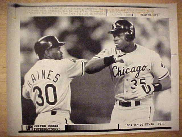 WIREPHOTO: Frank Thomas - {07/29/91} 'Round Tripper' (White Sox) Baseball cards value