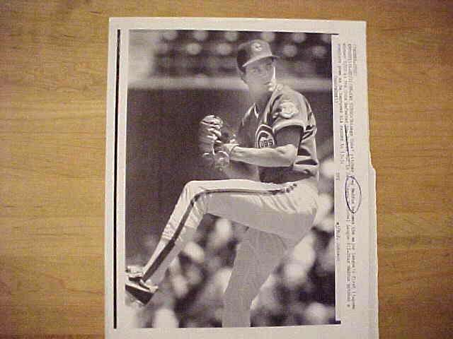 WIREPHOTO: Greg Maddux - {07/11/88} 'In The Bag!' (Cubs) Baseball cards value