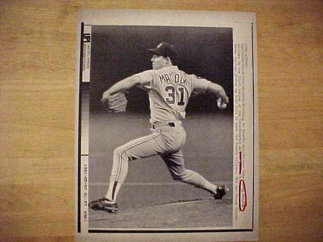 WIREPHOTO: Greg Maddux - {05/07/91} 'Bearing Down' (Cubs) Baseball cards value