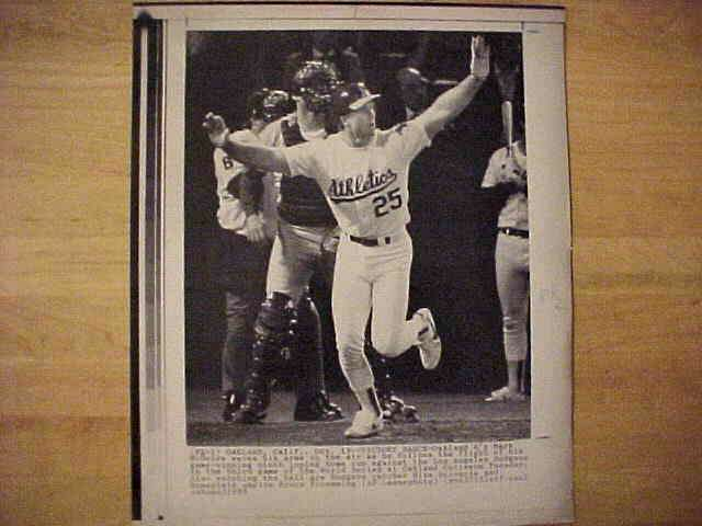 WIREPHOTO: Mark McGwire - {10/19/88} 'Victory Dance' (Athletics) Baseball cards value