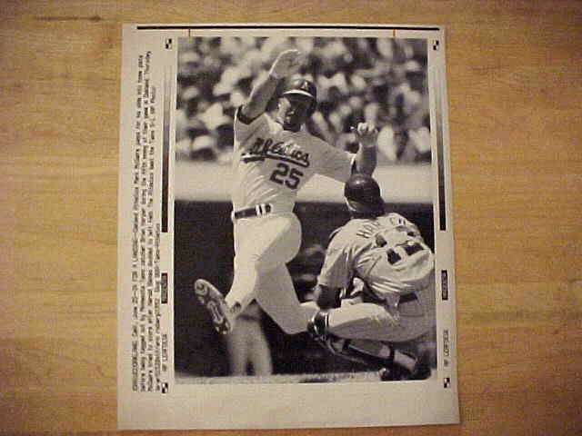 WIREPHOTO: Mark McGwire - {06/25/92} 'In For A Landing' (Athletics) Baseball cards value