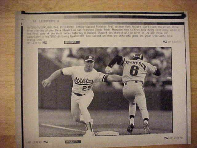 WIREPHOTO: Mark McGwire - {10/14/89} 'Errant Throw' (Athletics) Baseball cards value