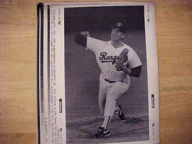 WIREPHOTO: Nolan Ryan - {04/09/90} 'Season Begins' (Rangers) Baseball cards value