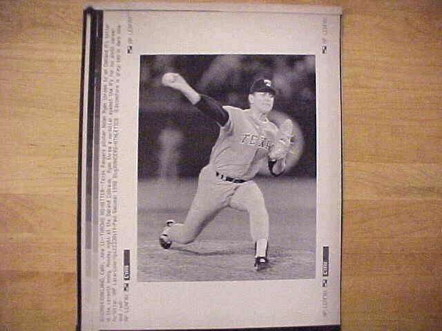WIREPHOTO: Nolan Ryan - {06/11/90} 'Throws No Hitter' Vertical (Rangers) Baseball cards value