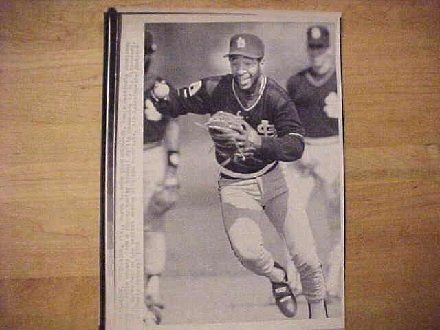 WIREPHOTO: Ozzie Smith - {03/02/88} 'Runs Them Down' (Cardinals) Baseball cards value