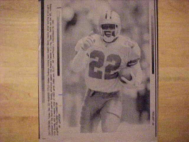 WIREPHOTO: Emmitt Smith - {12/22/91} 'Rushing Title' (Cowboys) Football cards value
