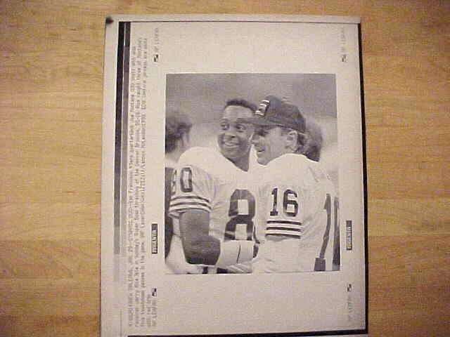 WIREPHOTO: Joe Montana - {01/29/90} 'Dynamic Duo' (49ers) Football cards value
