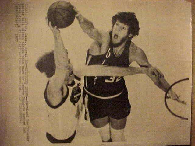 WIREPHOTO: Bill Walton - {04/20/77} 'Stopping Issel' (Trail Blazers) Basketball cards value