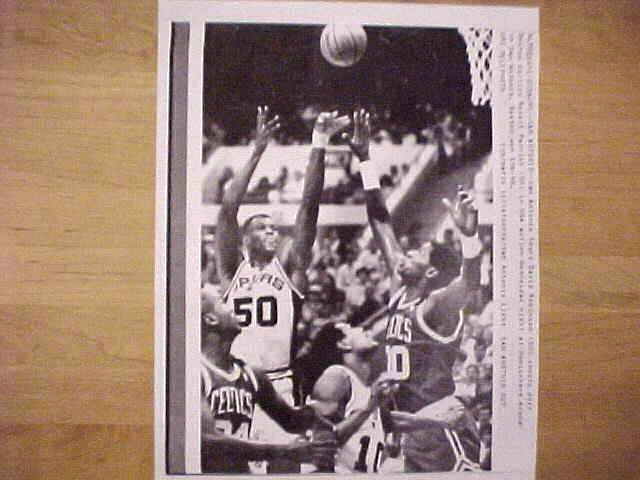 WIREPHOTO: David Robinson - {02/14/90} 'Over The Top' (Spurs) Basketball cards value