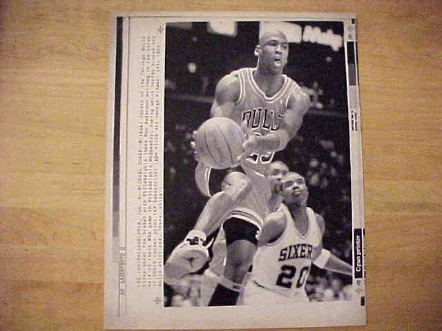 WIREPHOTO: Michael Jordan - {01/09/91} 'Michael Soars' (Bulls) Basketball cards value