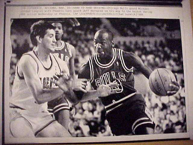 WIREPHOTO: Michael Jordan - {03/22/89} 'Hand To Hand Driving' (Bulls) Basketball cards value