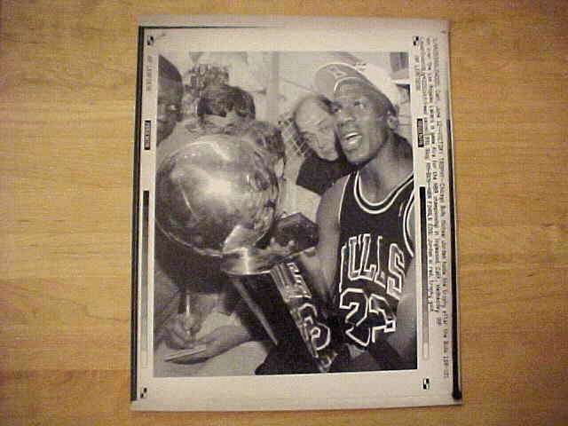 WIREPHOTO: Michael Jordan - {06/12/91} 'Victory Trophy' (Bulls) Basketball cards value