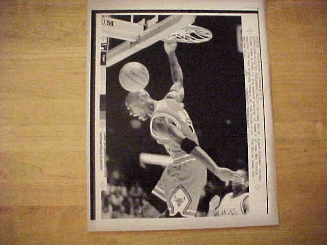 WIREPHOTO: Michael Jordan - {06/12/91} 'Through The Hoop' (Bulls) Basketball cards value