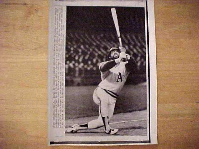 WIREPHOTO: Reggie Jackson - {04/17/74} 'Reggie Jackson Hits Himself' (A's) Baseball cards value