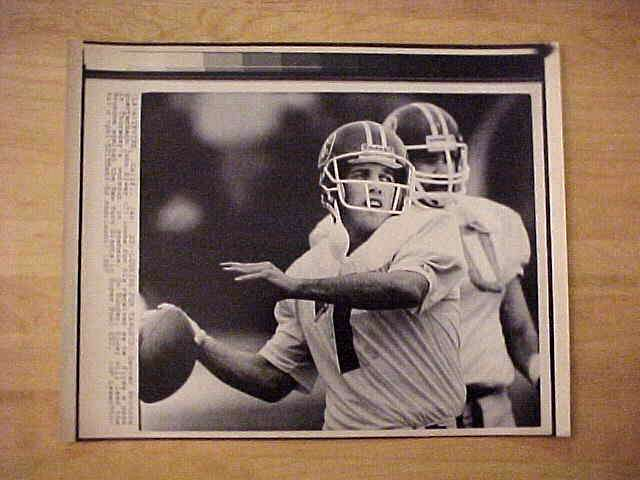 WIREPHOTO: John Elway - {01/23/87} 'Looking For Targets' (Broncos) Football cards value