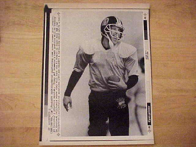 WIREPHOTO: John Elway - {01/17/87} 'Happy Bronco' (Broncos) Football cards value
