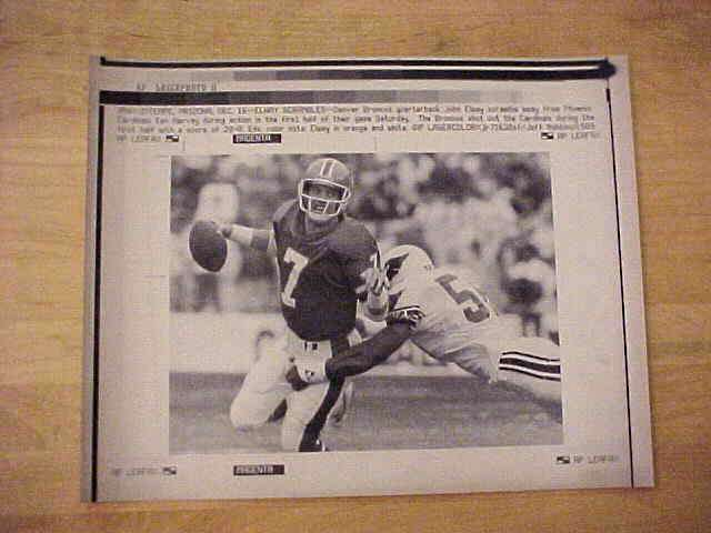 WIREPHOTO: John Elway - {12/16/89} 'Outta Here' (Broncos) Football cards value