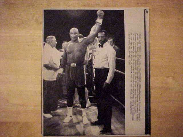 WIREPHOTO {Boxing}: George Foreman - {12/18/87} 'Foreman Wins' Boxing cards value