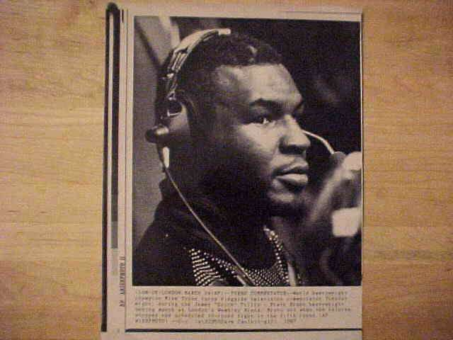 WIREPHOTO {Boxing}: Mike Tyson - {03/24/87} 'Turns Commentator' Boxing cards value
